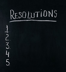New Years resolution concept using chalk on chalkboard.