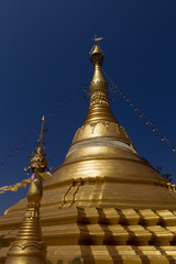 Amazing golden stupa, chedi and pagoda in buddhist temple in Thailand with deep blue sky background