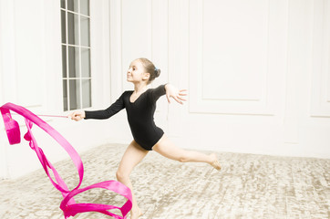 Beautiful sport training rhythmic gymnastic girl