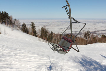 Ropeway on a mountain slope in the winter, a fragment , Altai, Russia