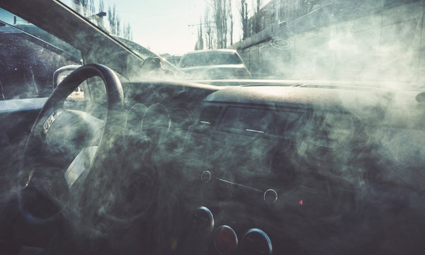 Car interior in smoke or vapour. Vape Inside car. Can be used as fire in automob