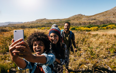 Group of friends on country hike taking selfie