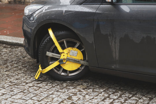 Car was locked with yellow clamped vehicle, wheel lock. Parking on forbidden place