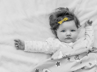 A small child with a yellow bow, black-and-white photograph.