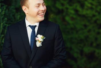 Portrait of happy handsome groom