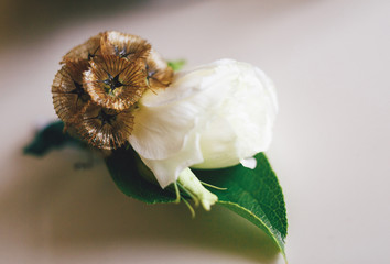 Beautiful boutonniere made from the white rose
