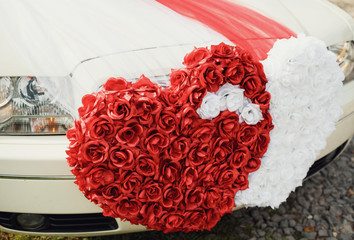 Wedding decoration on the luxury white car