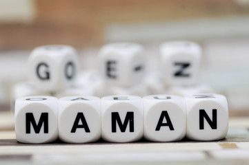 maman write in dice letters