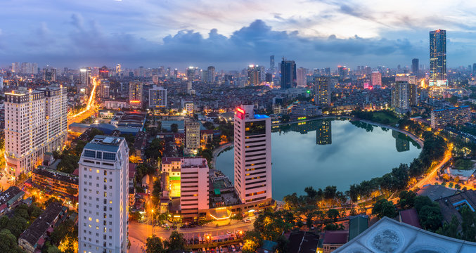 Hanoi city by twilight period, with Giang Vo lake, Ba Dinh district. Aerial skyline view.