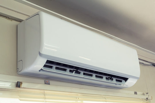 Air conditioner (AC) indoor unit or evaporator and wall mounted. That is part of mini split system or ductless system type. For removing heat and moisture from room, Temperature and humidity control.