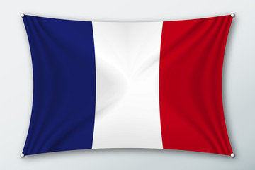 France national flag. Symbol of the country on a stretched fabric with waves attached with pins. Realistic vector illustration.