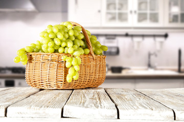 grapes fruits and wooden desk space