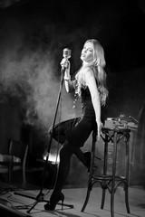 Attractive retro woman, singer. Noir style