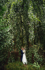 young couple embrace in a beautiful place