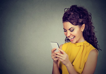 Woman typing text message on smart phone having a pleasant conversation