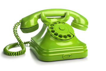 Green retro telephone on white background.