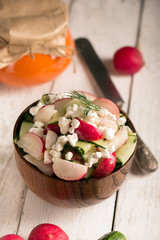 Salad with fresh vegetables and cottage cheese. White background