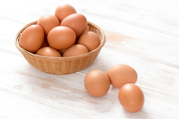 Brown Chicken Eggs in Basket and on Wooden Surface