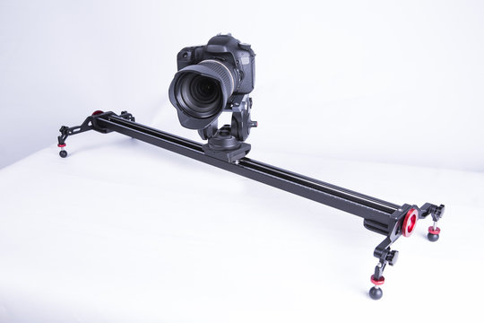 A studio shot of a linear camera slider on a white background.