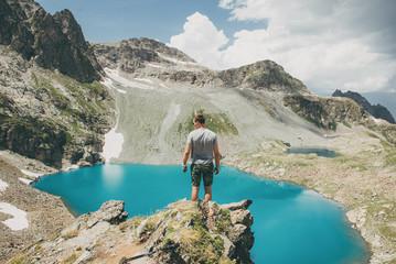 Man standing on rocks, Sofia Lake, Arkhyz, Karachay-Cherkessia Republic, Russia