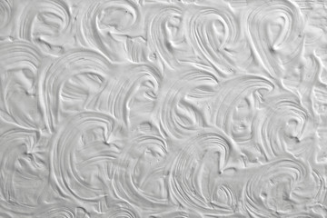Texture of white paint with cracks in retro style. Background for a card.