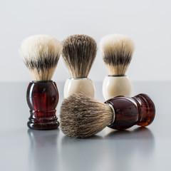 Shaving brush isolated on grey background.