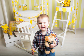 a crying boy inside a bright decorated white wooden room