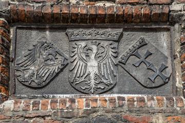The old polish royal emblem, the emblem of the city Gdansk, Danzig. Stone.
