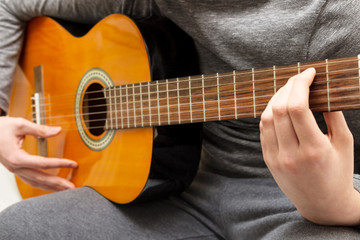 Acoustic guitar guitarist playing details