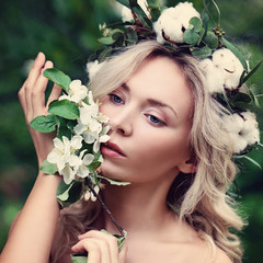 Nice Woman with White Flowers Wreath Outdoors. Natural Beauty