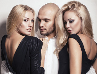 sexy gorgeous women with blond hair posing with handsome man