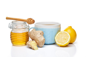 Honey and tea with spices and lemon.