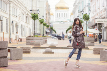beautiful woman walking in the city