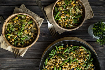 chickpea stew with green beans and onion, seasoned with rosemary. vegan food
