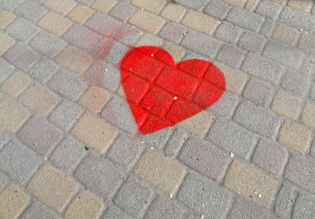 Picture of red heart on the paving tile