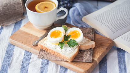 freshly boiled white egg on wooden board. Healthy fitness breakfast