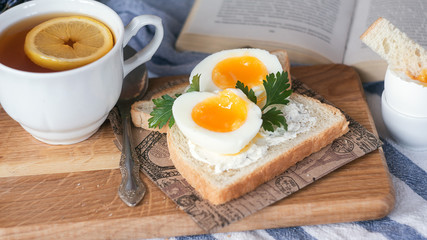 breakfast with boiled eggs and crispy toasts, closeup