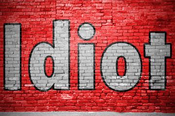 Idiot Ziegelsteinmauer Graffiti