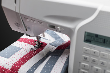 Sewing machine with quilt
