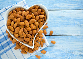 almonds on blue wooden surface