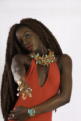 Thoughtful black woman reaching toward the camera