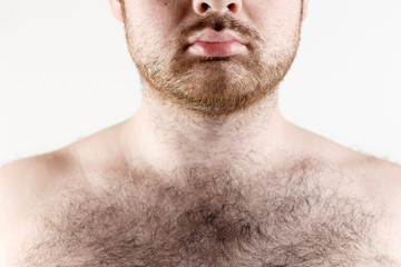 Close up of man moustache, beard and hairy chest