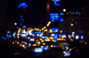 Colorful lights of car traffic in defocus, night, outdoor