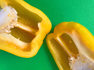 Yellow bell pepper on green