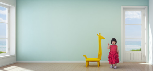 Asian child girl in kids room of modern beach house with empty turquoise wall background - 3d rendering