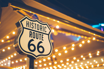 Stores photo Route 66 Historic Route 66 sign in California with decoration lights on the background