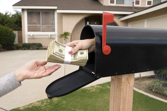 Mailbox handing over money