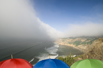 Coastal weather front and umbrellas