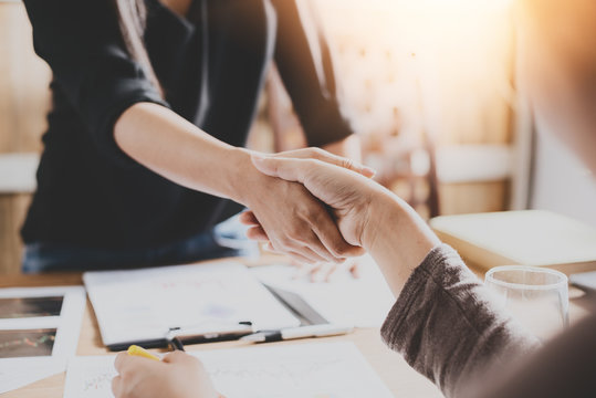Negotiating business,Image businesswomen handshake,happy with work,business woman she is enjoying with her workmate,Handshake Gesturing People Connection Deal Concept