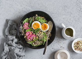 Spinach breakfast salad with quinoa, radish and egg. Healthy diet food concept. Top view
